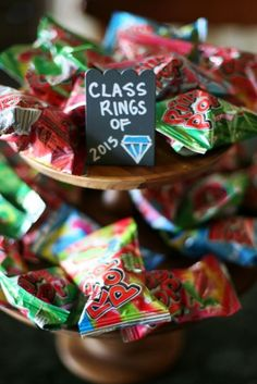 preschool graduation Graduation Party Candy Bar with sources for the treats and clever school themed candy names! Graduation Party Planning, Graduation Party Favors, College Graduation Parties, Graduation Celebration, Graduation Decorations, Graduation Party Decor, Grad Parties, Graduation Food, Graduation Table Ideas