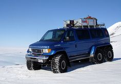 "These six-wheel-drive Science Support  Vehicles (SSVs) are pretty bad ass in their own right and will be used to transport explorers and their equipment. One has already  been used in a previous record-breaking drive to the South  Pole. A hardcore vehicle for the most extreme climate imagineble, the SSVs are powered by a low emission, turbo-charged 7.3 litre diesel V8 and feature fully independent air suspension with 26"" of travel on each wheel"