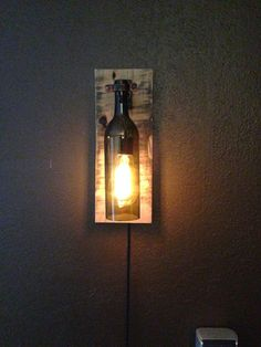 Hey, I found this really awesome Etsy listing at https://www.etsy.com/listing/184439562/rustic-wine-bottle-wall-light-sconce
