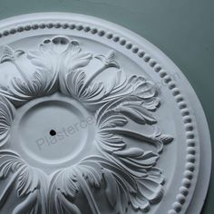This large ornate floral plaster ceiling rose is a fine piece of Victoriana, decorated with a leafy acanthus design interspersed with exotic flowers.