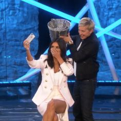 Talk about multi-tasking!  Kim Kardashian takes the ALS Ice Bucket Challenge...and a selfie