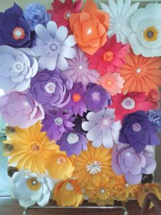 large paper flower installation on top and bordering draped backdrop for head table?
