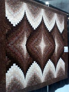 One of Eileen Wright's creations.   She wrote the book on twist and turn quilts