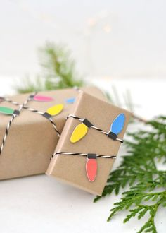 Why stop at your tree when decorating with Christmas lights? Print and cut out colorful bulbs, fold each in half, and use a glue pen to attach to twine. Then, simply wrap around your package and secure with tape.