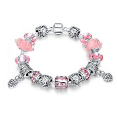 925 SILVER PLATED CHARM BRACELET WITH PRETTY PINK, CLEAR, SILVER, WHITE AND BLACK CHARMS.