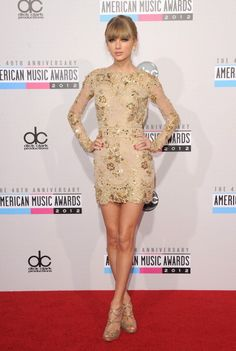 In a Zuhair Murad golden cocktail dress Taylor Swift at the 2012 #AMAS