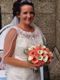 Coral and ivory hand tied by www.weddingflowersincornwall.co.uk