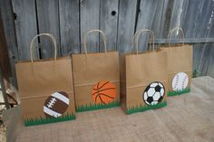 CALLING ALL SPORTS FANS!! **THE PERFECT THING TO STORE THE PARTING GIFTS FROM THAT FABULOUS SPORTS PARTY** This lising if for 8 Sports Party Favor Bags THE BAGS MEASURE 81/2 X 11. *2 Soccer *2 Basketball *2 Baseball *2 Football If you dont see what you are looking for I can customize it for you. If you want all of one specific ball. a mixture of half and half, or you want one that is not pictured please convo me and we can get you the bags you need. Balls not shown but offered: Golf Ball...