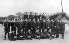 """Posing among pilots of No 501 Squadron RAF at RAF Kenley in 1940 are Sgt Konrad A Muchowski (sitting front, first left), Sgt Mieczysław S Marcinkowski (sitting front, second left), P/O Stanisław """"Stan"""" Skalski (sitting front, fourth left) and P/O Stefan Witorzeńć (standing, second right). Among the 4 and 1 shared destroyed and 2 damaged claimed by Witorzeńć was Hptm Horst Tietzen of JG51, who was shot down over the Thames Estuary on 18 August, shortly after recording his 20th victory."""
