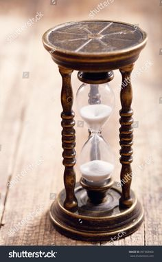 retro hourglass on wooden table Hourglass Tattoo, Hourglass Figure, Sand Glass, Wooden Tables, Awesome Things, Compass, Grains, Lost, Pocket