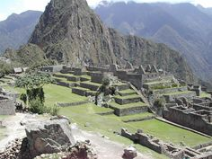 """""""Machu Picchu is a 15th-century Incan site located on a ridge between the Huayna Picchu and Machu Picchu mountains in Peru. It sits 7,970 feet (2,430 meters) above sea level on the eastern slope of the Andes and overlooks the Urubamba River hundreds of feet below."""""""