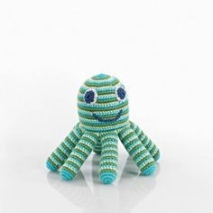 Green Smiling Octopus Rattle –   Smiling is contagious! This hand crochet octopus rattle will likely bring a smile to your little one. He's so smiley and friendly and with eight perfectly sized legs there's plenty of choice for grabbing and chewing.