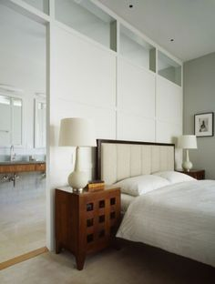 """Expand and enlarge. """"This home's master bedroom and master bath both have a limited amount of available square footage,"""" says Neal Schwartz of Schwartz and Architecture. """"We dealt with this by treating the room divider as a piece of cabinetry rather than a traditional wall."""""""