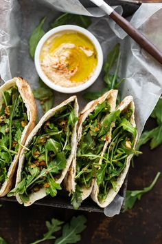 A vegetarian stuffed pita filled with hummus, arugula, and a homemade olive tapenade- the perfect lunch for at home or on the go!