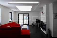 Family house illuminated with continous light ceiling using Barrisol stretch foil and LED modules. Entire ceiling lamp in living room with uniform light distribution.