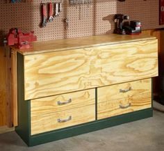Garage workbench with the top folded down-- Great way to always have some space available.