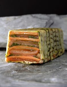 A fresh summer dish for next year, pressed Terrine of tomato,sweet potato, coriander and peppers wrap into grilled courgettes