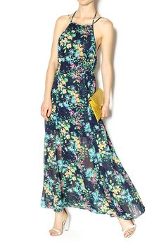 This floral printed maxi features a halter neck that leaves much of the back exposed for a flirty look. Also features a tied waist to show off your shape and is partially lined. Semi sheer. Dry clean only. Cool iron if necessary.   Floral Maxi Dress by I. Madeline. Clothing - Dresses - Maxi Clothing - Dresses - Wedding Wear Clothing - Dresses - Floral Manhattan, New York City