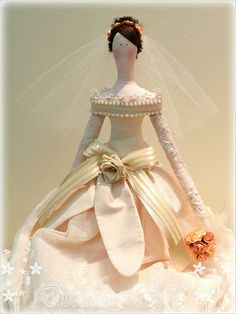 Gorgeous dress. A lot of work has gone into this Tilda doll.