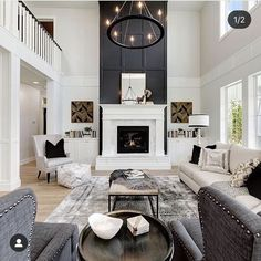from Thrifty Decor Chick How to give a tall fireplace wall a ton of character and drama with molding and paint. Tall Fireplace, Home Fireplace, Fireplace Remodel, Living Room With Fireplace, Fireplace Design, Home Living Room, Living Room Designs, Fireplace Ideas, Two Story Fireplace
