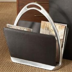 Black Leather Stirrup Magazine Rack from www.wellappointedhouse.com