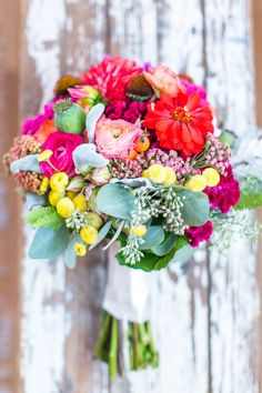 Colorful Bouquet! See the wedding: http://www.StyleMePretty.com/mid-atlantic-weddings/2014/04/11/rustic-meets-preppy-north-carolina-wedding-at-claxton-farm/  StephanieYoncePhotography.com || Wedding Bouquet: Bloom-Room.com