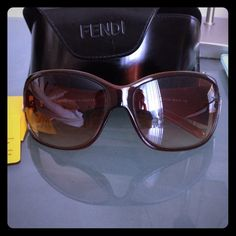 Fendi sunglasses Brown Fendi sunglasses, in good condition with no apparent scratches on lenses, only missing one rhinestone shown in picture, comes with case, Fendi sunglass cleaning cloth, and international guarantee card. FENDI Accessories Sunglasses