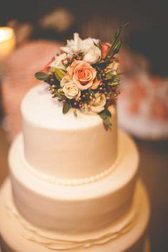 simple wedding cake with flower garnish