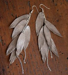 These earrings are made with feather like shapes, handcut out of high quality Italian leather. Attached to silver plated chains and silver plated ear hooks. They are really lightweight and soft. The overall length is around 4.5 inches I also have them in: WHITE: