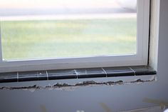 How we removed tile from our window sill...
