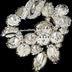For sale at Retrophoria.com, $75.00 -  Faceted & paved diamond cut crystals set into rhodium.