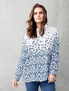 Blouse in super fashionable floral pattern color gradient. Easy-care fabric – wash and wear. Comfortably styled with shirt collar, button front and long button cuff sleeves. <br />