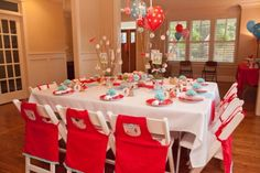Love this table set up for a Little Red Riding Hood birthday party theme