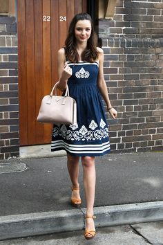 A slight pear... and quite close to hourglass Miranda Kerr defines her lovely waist in this blue dress. The print and the cut both flatter