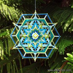 ojo de dios a mandala woven from yarn. by MandalaArtByCloe on Etsy