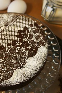 1. Use lace over a chocolate cake   2. Sprinkle with powered sugar  3. Carefully remove lace