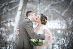 On a snowy day, love will prevail. Love never stops as the seasons change, and the snow falls. Winter wedding. Photo by Dempag Photography.