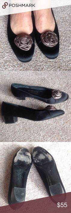 Salvatore Ferragamo black satin shoes In great used condition. Plenty of life left. The flower design is made of soft leather.         .                           e Salvatore Ferragamo Shoes