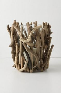 Driftwood candle holder inspiration from antro. Glue driftwood sticks on glass votive candle holder or hurricane vase. I actually have this, got it at TJMAXX and it looks great with candles lit, Like a bonfire for the inside of your house :) Driftwood Projects, Driftwood Art, Diy Projects, Driftwood Table, Driftwood Beach, Beach Wood, Eclectic Candles, Driftwood Candle Holders, Votive Holder