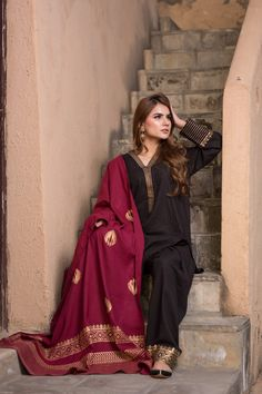 Black suit with block printed sleeves and neck line. Shalwar is having golden block print on panchas. Dress is paired with cherry maroon duppata with golden block print. Shawl color remain same maroon in all color suits Stylish Dresses For Girls, Stylish Dress Designs, Designs For Dresses, Simple Dresses, Casual Dresses, Pakistani Fashion Party Wear, Pakistani Outfits, Indian Outfits, Indian Dresses