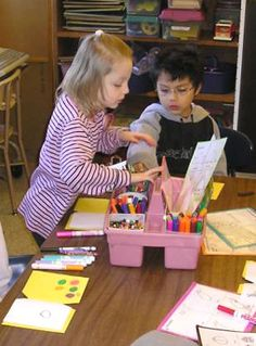 Portable Writing Center invites children to make a simple books and pictures without taking up too much space.