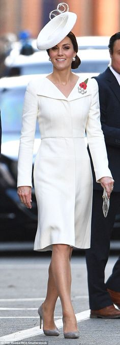The Duchess of Cambridge arrived wearing a white Alexander McQueen coat-dress...