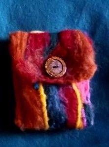 Needle felting with wool to create felt wallets.