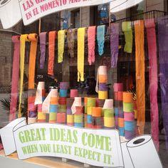 Lots of coloured toilet roll! Fun window display in Barcelona