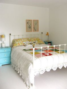 vintage styled bedroom, iron bed, painted nightstands