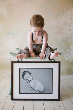 First Birthday. Incorporate babies newborn photo. I love this because he happened to want to look at it more than me. Baby stages photography session in home, studio style.