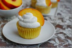 peaches n cream cupcakes with homemade whipped cream frosting
