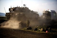 Israeli News | An Israeli Merkava tank is positioned for deployment during a drill in ...