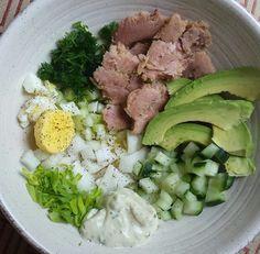 Tuna, cucumbers, diced celery, chopped celery leaves, homemade ranch dressing, half a hard-boiled egg