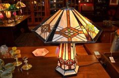 18040LB This is a beautiful stained glass lamp made with individual hand-cut pieces of glass soldered together to make this gorgeous lamp. It is hand crafted using the same rich techniques and designs